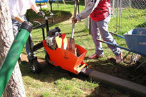 concrete curbing machine, extruding concrete, decorative landscape borders, golden co